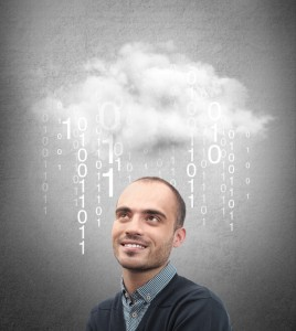 Young business man or system administrator under cloud with digi